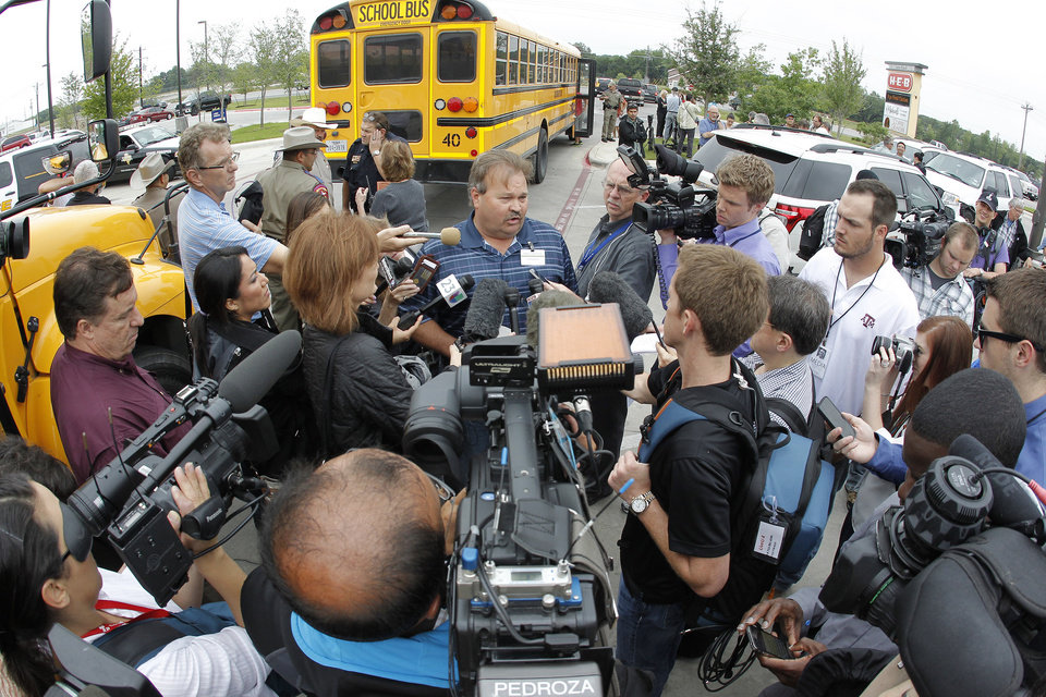 Photo - Hood County Commissioner Steve Berry, center, talks to the media before the bus tour of the ravaged residential area Rancho Brazos in Granbury, Texas, Thursday May 16, 2013. Ten tornadoes touched down in several small communities in North Texas overnight, leaving at least six people dead, dozens injured and hundreds homeless.   (AP Photo/The Fort Worth Star-Telegram,Paul Moseley)  MAGS OUT; (FORT WORTH WEEKLY, 360 WEST);