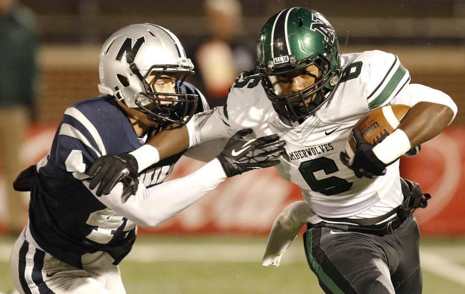 EN#4 Lance Dixon wraps up NN#6 Z'quan Hogan during the high school football game between Norman North and Edmond North in Edmond at Wantland Stadium Friday, Friday, October 18, 2013.  Photo by Doug Hoke, The Oklahoman