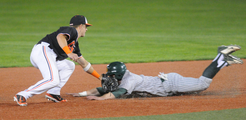 Photo - Oregon State's Andy Peterson tags out North Dakota State's Tim Colwell on a steal attempt of second base during an NCAA college baseball regional tournament game in Corvallis, Ore., Friday, May 30, 2014. (AP Photo/Mark Ylen)
