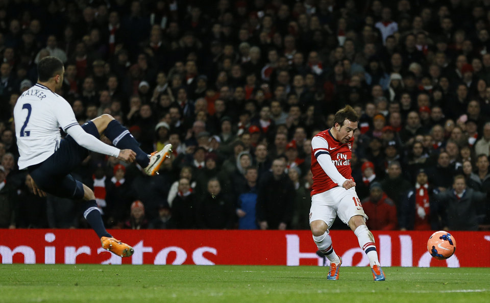 Photo - Arsenal's Santi Carzola, right, shoots and scores the opening goal during the English FA Cup third round soccer match between Arsenal and Tottenham Hotspur at the Emirates Stadium in London, Saturday, Jan. 4, 2014. (AP Photo/Kirsty Wigglesworth)