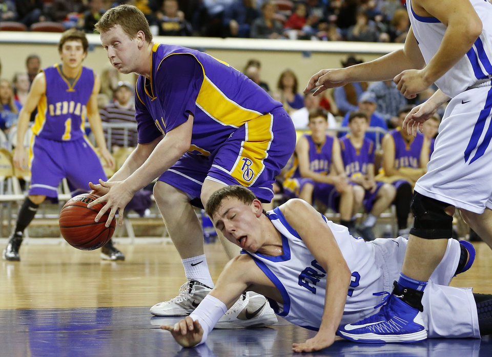 Photo - Red Oak's Dylan Fazekas, left, gains control of the ball in front of Fargo's Tyler Foale during a Class B Boys game of the state high school basketball tournament between Fargo and Red Oak at the State Fair Arena at State Fair Park in Oklahoma City, Thursday, Feb. 28, 2013. Photo by Bryan Terry, The Oklahoman
