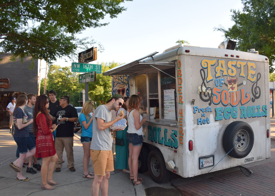 Photo - Food truck fans line up at Taste of Soul Egg Roll during LIVE on the Plaza Friday, June 13, 2014 in Oklahoma City. Photo by NewsOK contributor K. Mennem