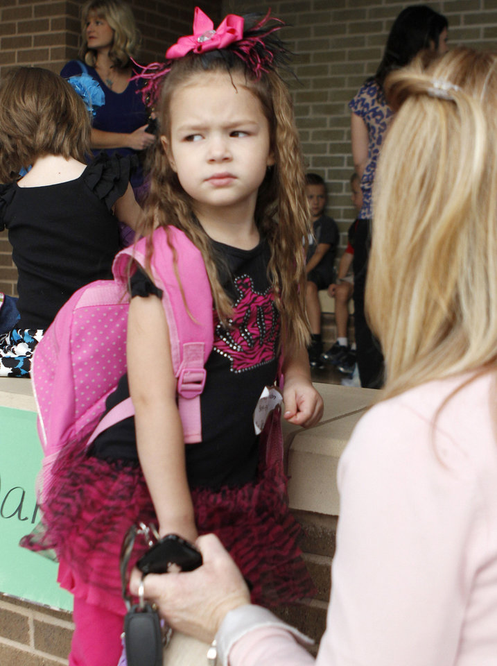 Michelle Keylon tries to reassure her 5- year-old daughter, Kinley, as she begins the first day of her kindergarten classes Friday at Will Rogers Elementary School in Edmond. Photo  By Paul Hellstern, The Oklahoman <strong>PAUL HELLSTERN</strong>