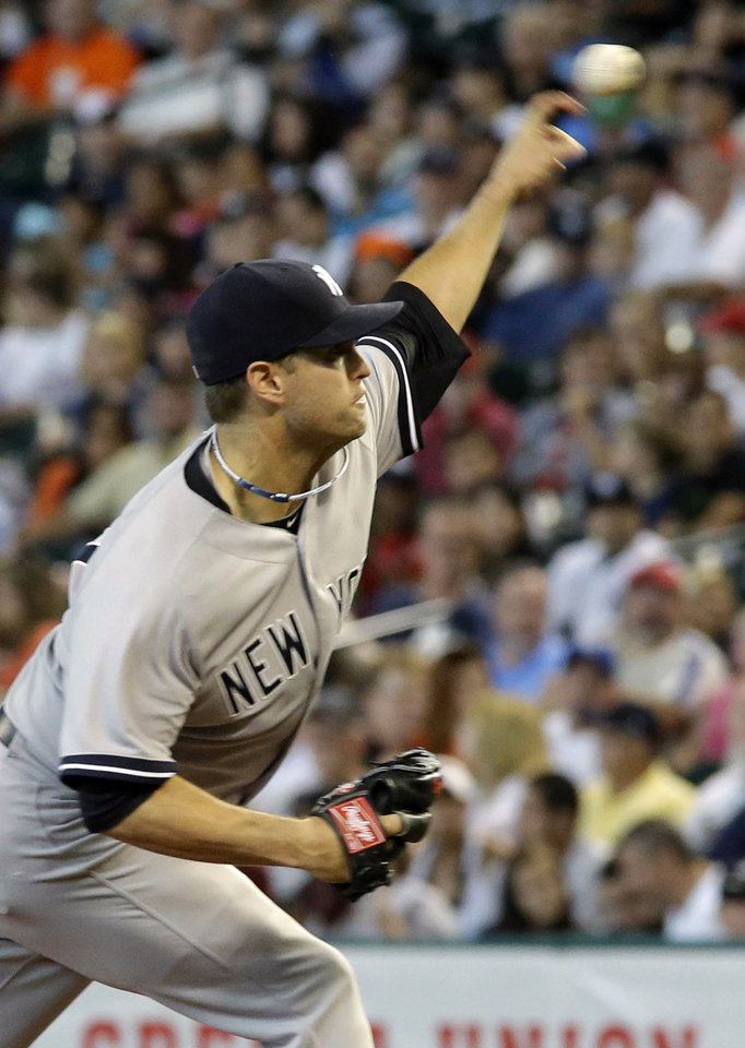 Photo - New York Yankees starting pitcher David Huff delivers a pitch against the Houston Astros during the first inning of their baseball game Sunday, Sept. 29, 2013, in Houston. (AP Photo/Richard Carson)