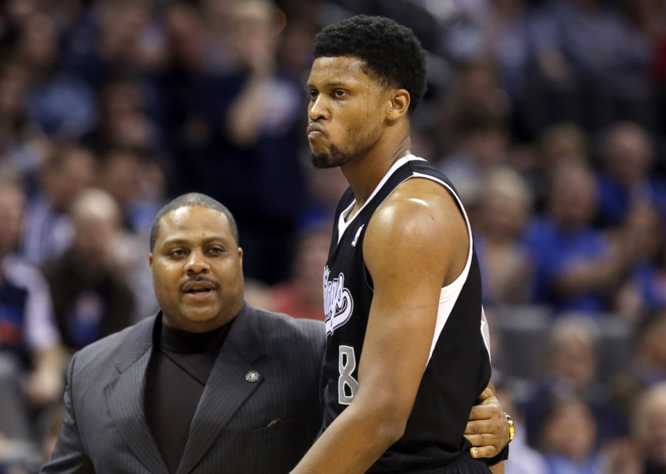 Photo - Sacramento's Rudy Gay (8) is escorted off the court after being ejected during the NBA game between the Oklahoma City Thunder and the Sacramento Kings at the Chesapeake Energy Arena, Sunday, Jan. 19, 2014.  Photo by Sarah Phipps, The Oklahoman