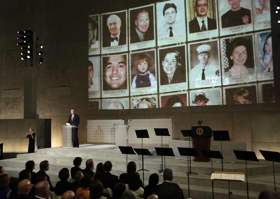 Photo - Former New York Gov. George Pataki speaks as photos of 9/11 victims are projected, during the dedication ceremony in Foundation Hall, of the National September 11 Memorial Museum, in New York, Thursday, May 15, 2014. (AP Photo/Richard Drew, Pool)