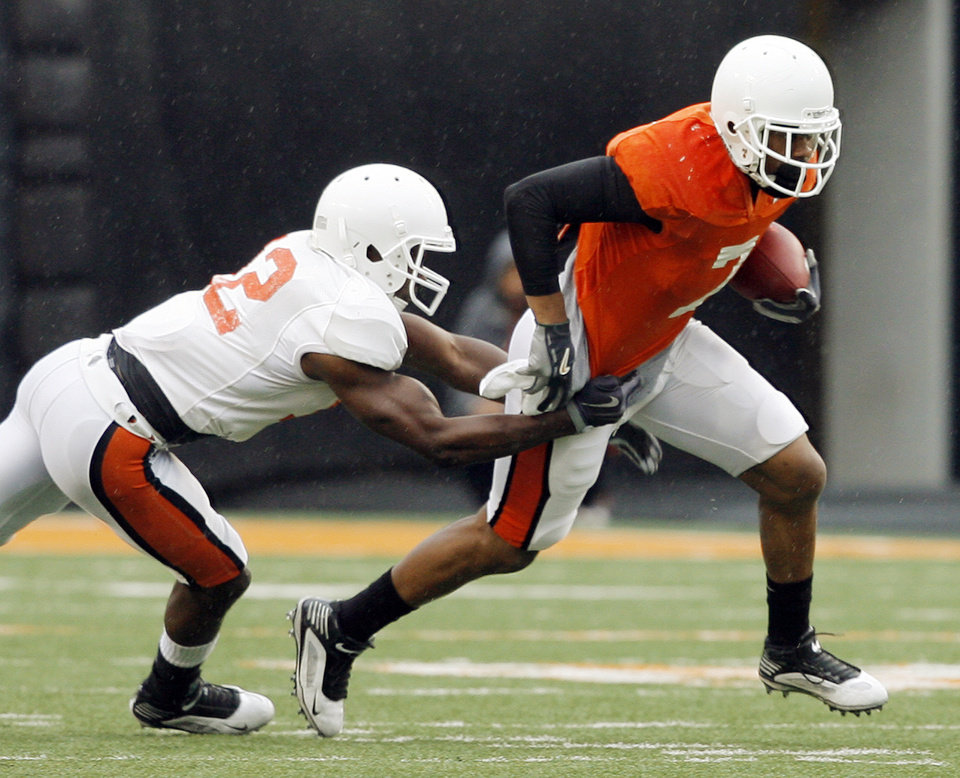 Photo - OSU's Johnny Thomas (12) tackles Michael Harrison (7) during the Oklahoma State Orange and White spring football game at Boone Pickens Stadium in Stillwater, Okla., Saturday, April 17, 2010. Photo by Nate Billings, The Oklahoman