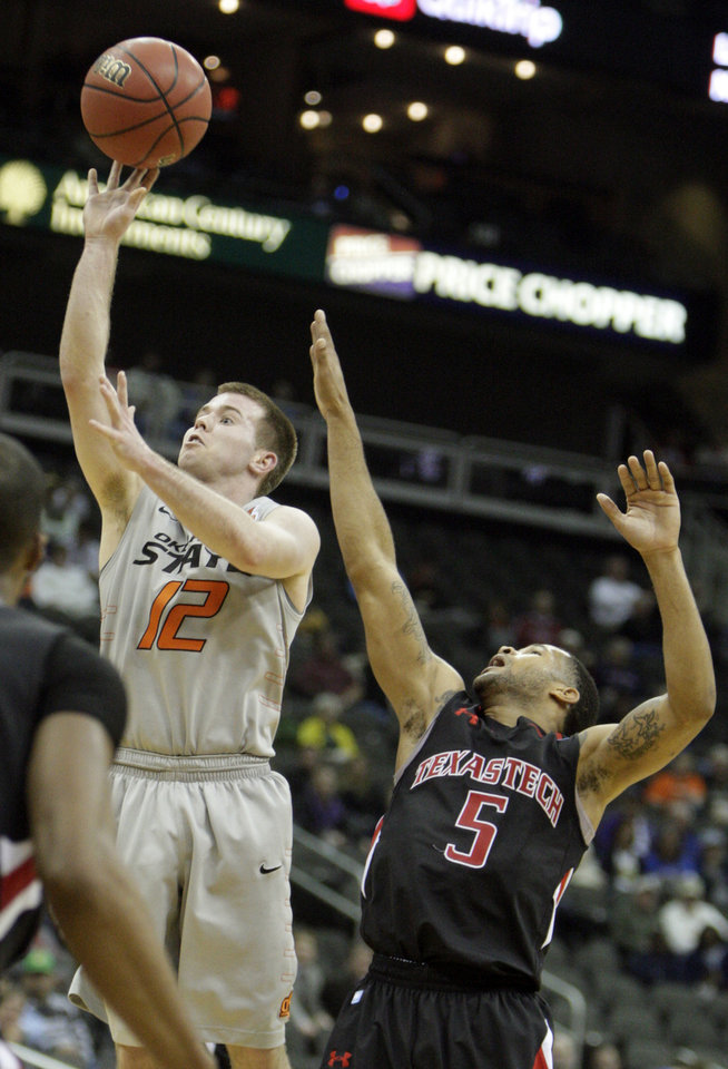 Oklahoma State's Keiton Page (12) shoots as Texas Tech's Javarez Willis (5) defends during the Big 12 tournament men's basketball game between the Oklahoma State Cowboys and the Texas Tech Red Raiders at the Sprint Center, Wednesday, March, 7, 2012. Photo by Sarah Phipps, The Oklahoman