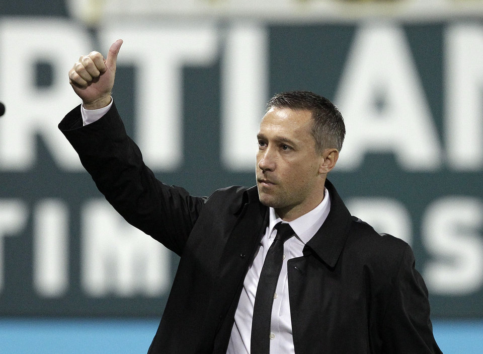 Portland Timbers coach Caleb Porter gives a thumbs up to fans before the second game of the Western Conference finals in the MLS Cup soccer playoffs, against Real Salt Lake Sunday, Nov. 24, 2013, in Portland, Ore. (AP Photo/Don Ryan)