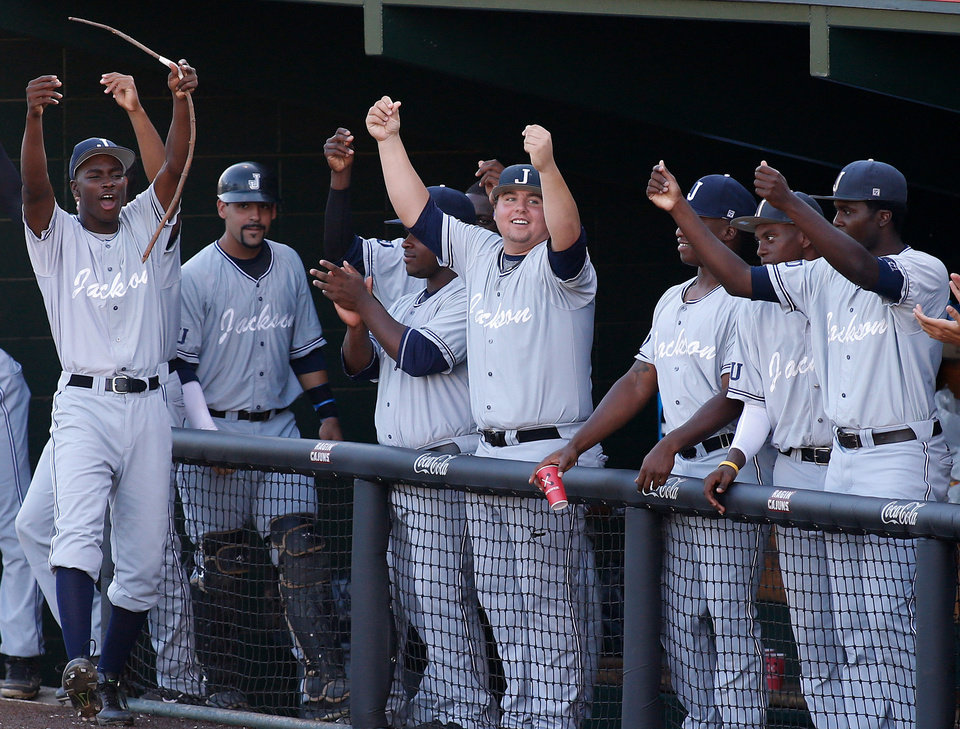 Jackson State\'s dugout celebrates after teammate Desmond Russell (not shown) scored the team\'s only run in the fourth inning during an NCAA college baseball tournament regional game against Louisiana-Lafayette in Lafayette, La., Friday, May 30, 2014. Jackson State won 1-0. (AP Photo/Jonathan Bachman)