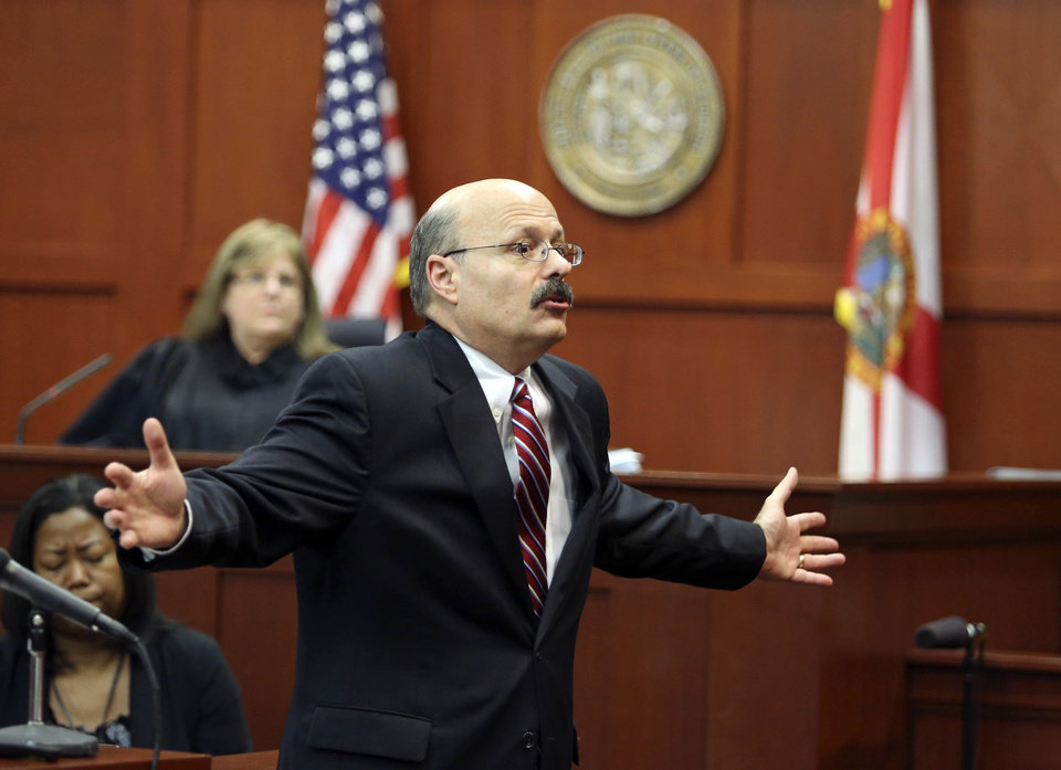 Photo - Assistant state attorney Bernie de la Rionda presents the state's closing arguments in George Zimmerman's trial in Seminole circuit court in Sanford, Fla. Thursday, July 11, 2013. Zimmerman has been charged with second-degree murder for the 2012 shooting death of Trayvon Martin. (AP Photo/Orlando Sentinel, Gary W. Green, Pool)