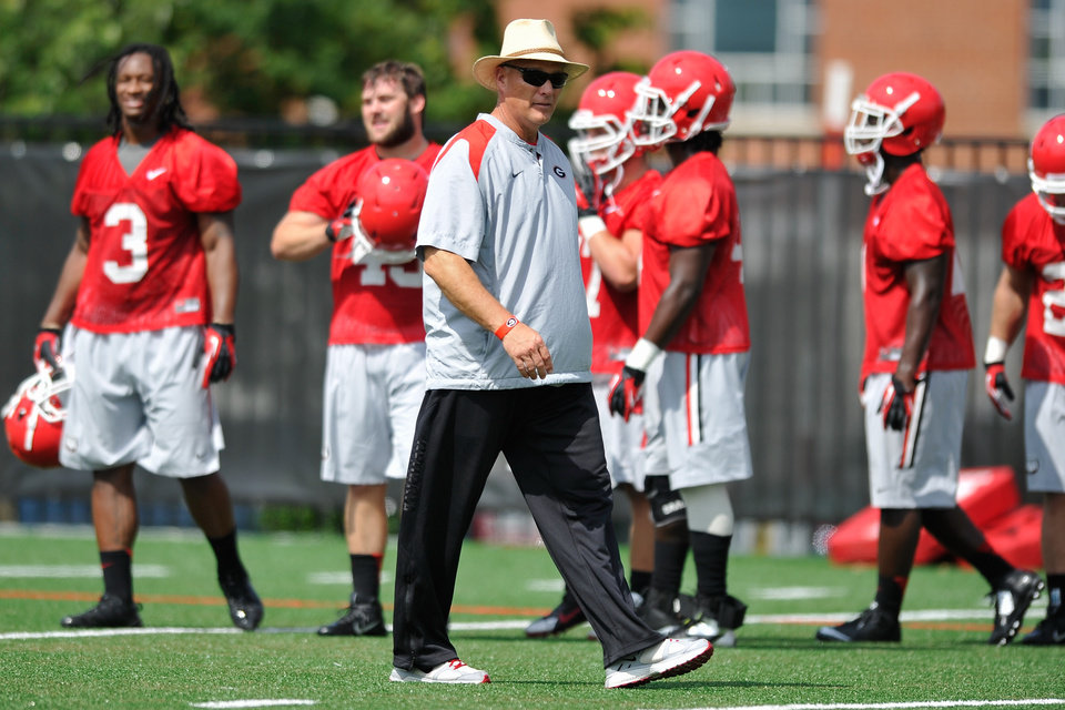 Photo - CORRECTS NAME OF PHOTOGRAPHER IN CAPTION - Georgia coach Mark Richt watches his players during NCAA college football practice Friday, Aug. 1, 2014, in Athens, Ga. (AP Photo/Athens Banner-Herald, AJ Reynolds)