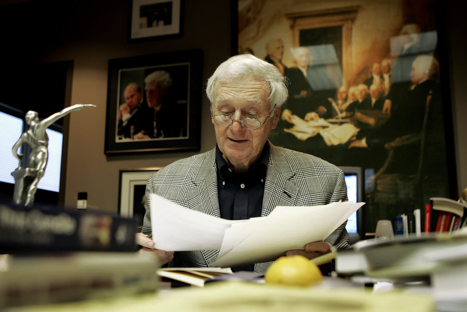 Photo - FILE - In this Monday, Dec. 5, 2005 file photo, John Seigenthaler works in his office in Nashville, Tenn. Seigenthaler, the journalist who edited The Tennessean newspaper, helped shape USA Today and worked for civil rights during the Kennedy administration, died Friday, July 11, 2014. He was 86. (AP Photo/Mark Humphrey)