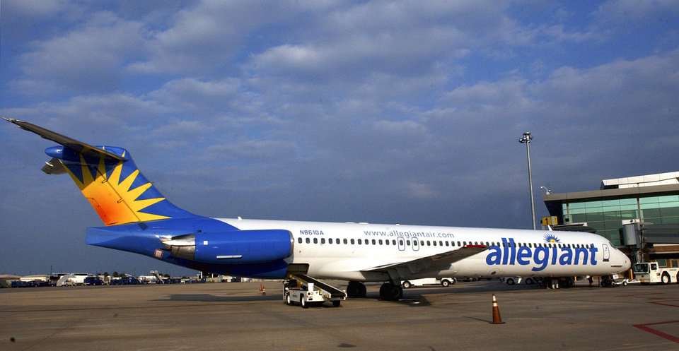Photo - OKLAHOMA CITY, OKLA., THURSDAY 10/28/04:  Allegiant Airlines' daily flight to Las Vegas from Oklahoma City starts today.  The plane is parked at the new terminal at Will Rogers World Airport.  Photo by Michael Downes, The Oklahoman.