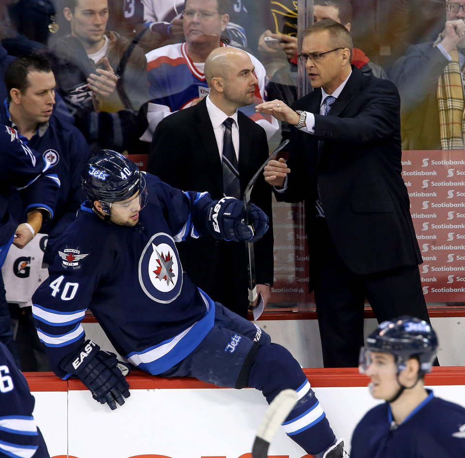 Photo - Winnipeg Jets' Assistant Coach Pascal Vincent and head coach Paul Maurice talk during first period NHL hockey action in Winnipeg, Canada, Monday, Jan. 13, 2014. (AP Photo/The Canadian Press, Trevor Hagan)