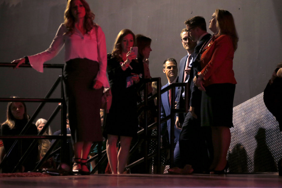 Photo - Matt Pinnell waits to take the stage before giving his acceptance speech at the Republican election night watch party for the 2018 elections at the Bricktown Events Center in Oklahoma City, Nov. 6, 2018. Photo by Bryan Terry, The Oklahoman
