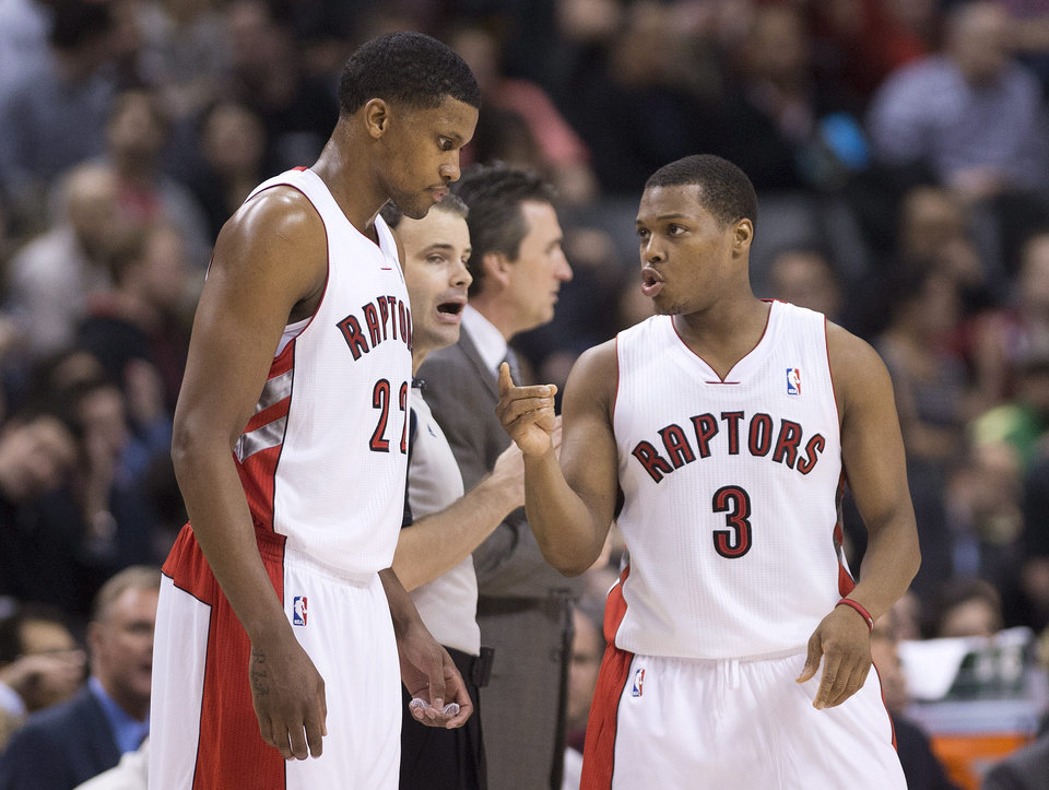 Toronto Raptors forward Rudy Gay, left, talks with guard Kyle Lowry during the first half of an NBA basketball game against the Los Angeles Clippers in Toronto on Friday, Feb. 1, 2013. (AP Photo/The Canadian Press, Nathan Denette)