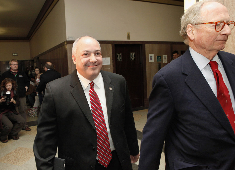 State Rep. Randy Terrill appeared Monday afternoon, Jan. 3, 2011, before Special Judge  Russell Hall in an Oklahoma County courtroom to enter a plea on bribery charges.  Terrill arrives smiling, accompanied by his attorney, Stephen Jones, right. Photo by Jim Beckel, The Oklahoman