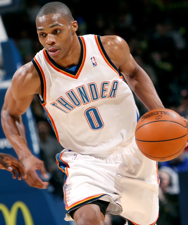 Photo - Oklahoma City's Russell Westbrook takes the ball downcourt against Philadelphia during the first half of their NBA basketball game at the Ford Center in Oklahoma City on Tuesday, Dec. 2, 2009. By John Clanton, The Oklahoman