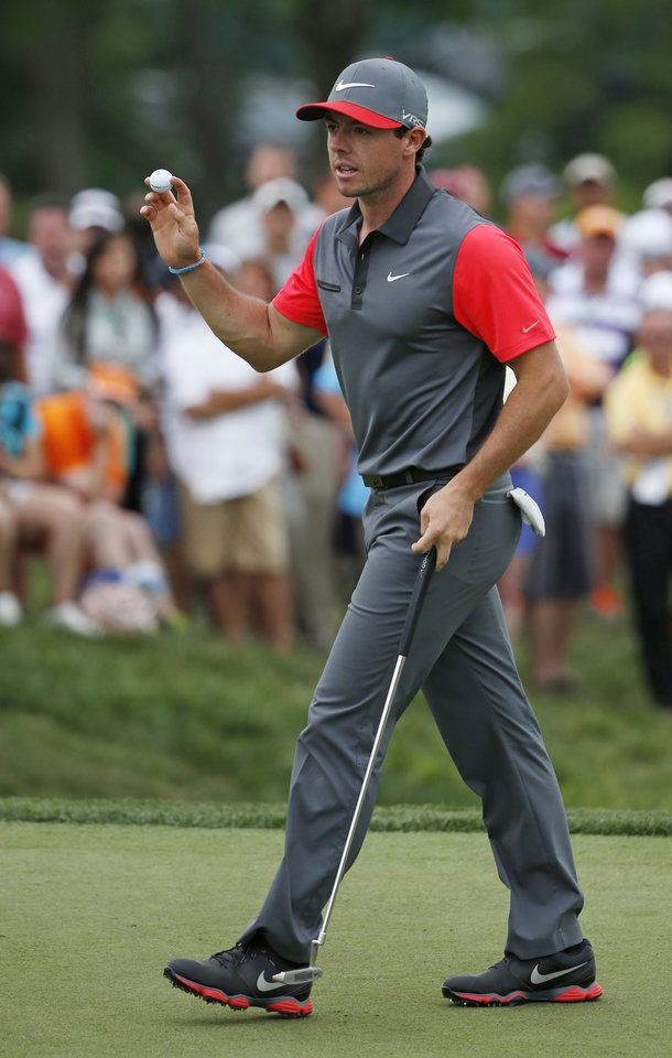 Photo - Rory McIlroy, of Northern Ireland, waves after making a birdie putt on the ninth hole during the first round of the PGA Championship golf tournament at Valhalla Golf Club on Thursday, Aug. 7, 2014, in Louisville, Ky. (AP Photo/Mike Groll)
