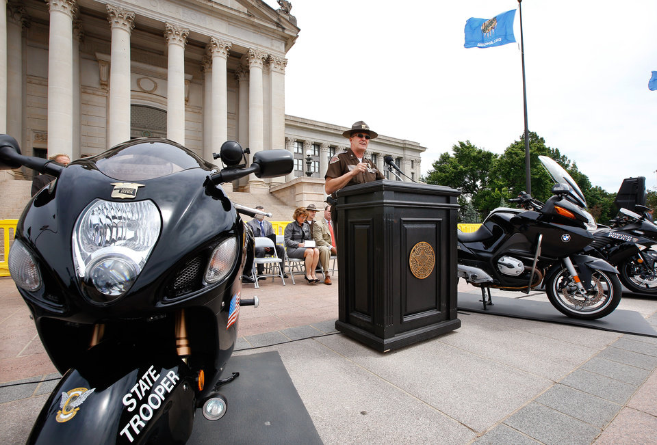 Photo - Oklahoma Highway Patrol Chief Rick Adams speaks during the safety event.  The Oklahoma Highway Patrol, Moore PD, Edmond PD, Tulsa PD, Norman PD and Broken Arrow PD were all represented. The Second Annual Motorcycle Safety Awareness Day was conducted on Tuesday, May 5, 2015, on the south plaza of the state Capitol.  May is National Motorcycle Safety Awareness Month and this event was to promote motorcycle safety in Oklahoma.  Organizers of the program encouraged motorcycle riders to wear helmets and other protective gear, to be properly licensed and actively seek training.  All motorists should participate in the