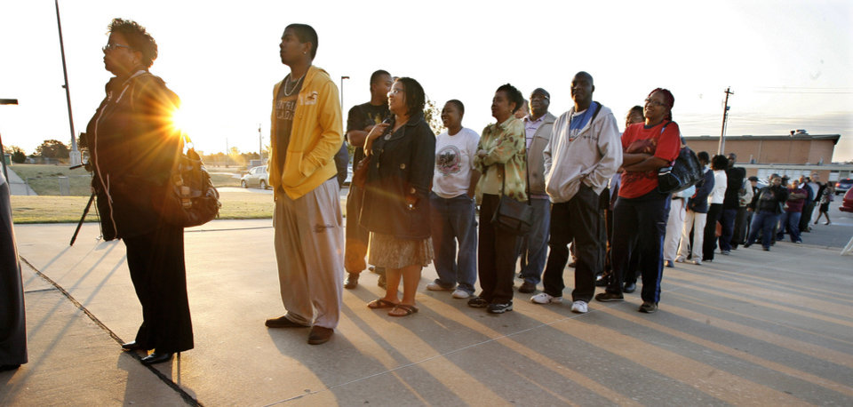 Photo - Voters line up as the sun rises at precinct 551 to vote at Millwood High School in Oklahoma City Tuesday, Nov. 4, 2008. BY PAUL B. SOUTHERLAND, THE OKLAHOMAN