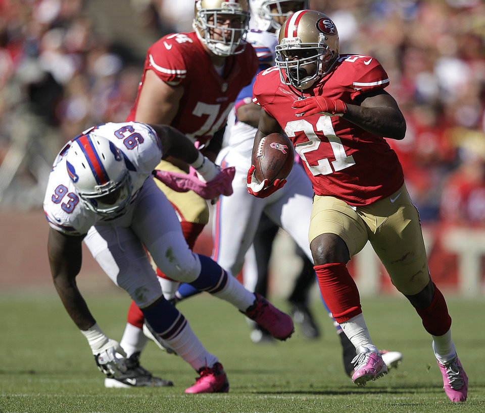 San Francisco 49ers running back Frank Gore (21) runs past Buffalo Bills defensive end Mark Anderson (93) during the third quarter of an NFL football game in San Francisco, Sunday, Oct. 7, 2012. (AP Photo/Ben Margot)