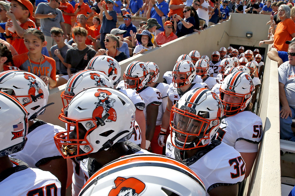 Photo - Oklahoma State enters the field during a college football game between the Oklahoma State University Cowboys (OSU) and the University of Tulsa Golden Hurricane (TU) at H.A. Chapman Stadium in Tulsa, Okla., Saturday, Sept. 14, 2019. [Sarah Phipps/The Oklahoman]