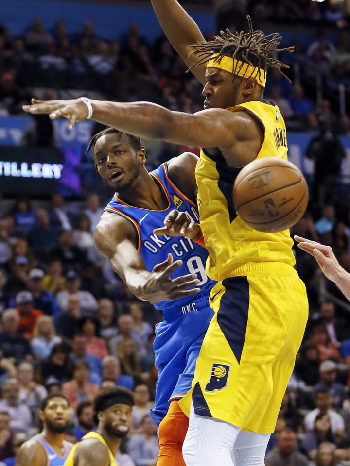 Photo - Oklahoma City's Jerami Grant (9) passes around Indiana's Myles Turner (33) during an NBA basketball game between the Indiana Pacers and the Oklahoma City Thunder at Chesapeake Energy Arena in Oklahoma City, Wednesday, March 27, 2019. Photo by Nate Billings, The Oklahoman