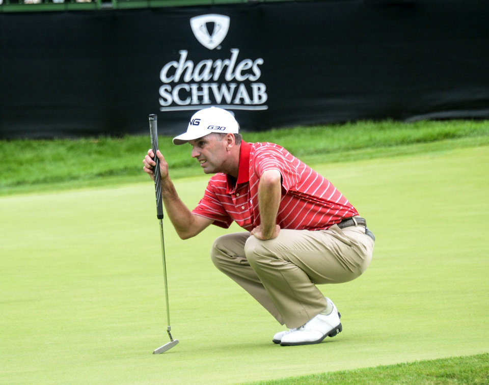 Photo - Kevin Sutherland lines up his putt on the 18th green during second round of the Dick's Sporting Goods Open on Champions Tour golf tournament, Saturday, Aug. 16, 2014, in Endicott, N.Y. Sutherland shot the first 59 in Champions Tour history Saturday. Six players have shot a 59 on the PGA Tour. (AP Photo/Press & Sun-Bulletin, Kristopher Radder)  NO SALES