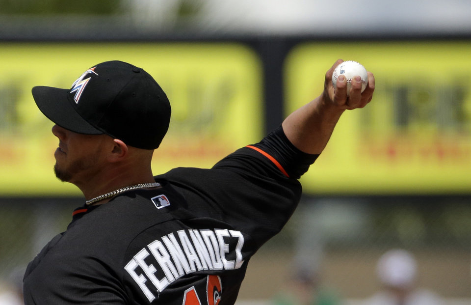 Photo - Miami Marlins starting pitcher Jose Fernandez throws in the first inning of an exhibition spring training baseball game against the St. Louis Cardinals, Tuesday, March 25, 2014, in Jupiter, Fla. (AP Photo/David Goldman)