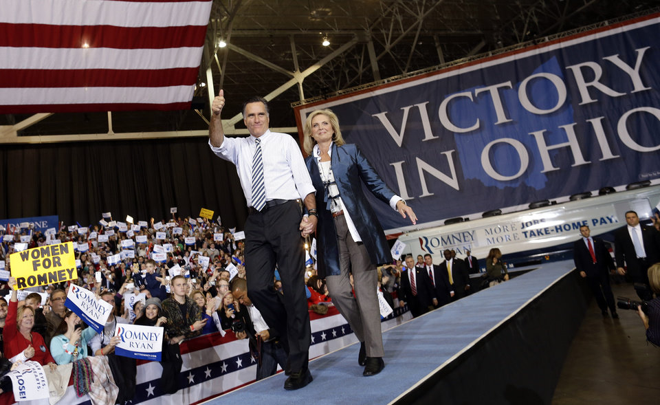 Republican presidential candidate and former Massachusetts Gov. Mitt Romney and Ann Romney take the stage as they campaign at the International Exposition Center in Cleveland, Sunday, Nov. 4, 2012. (AP Photo/Charles Dharapak)