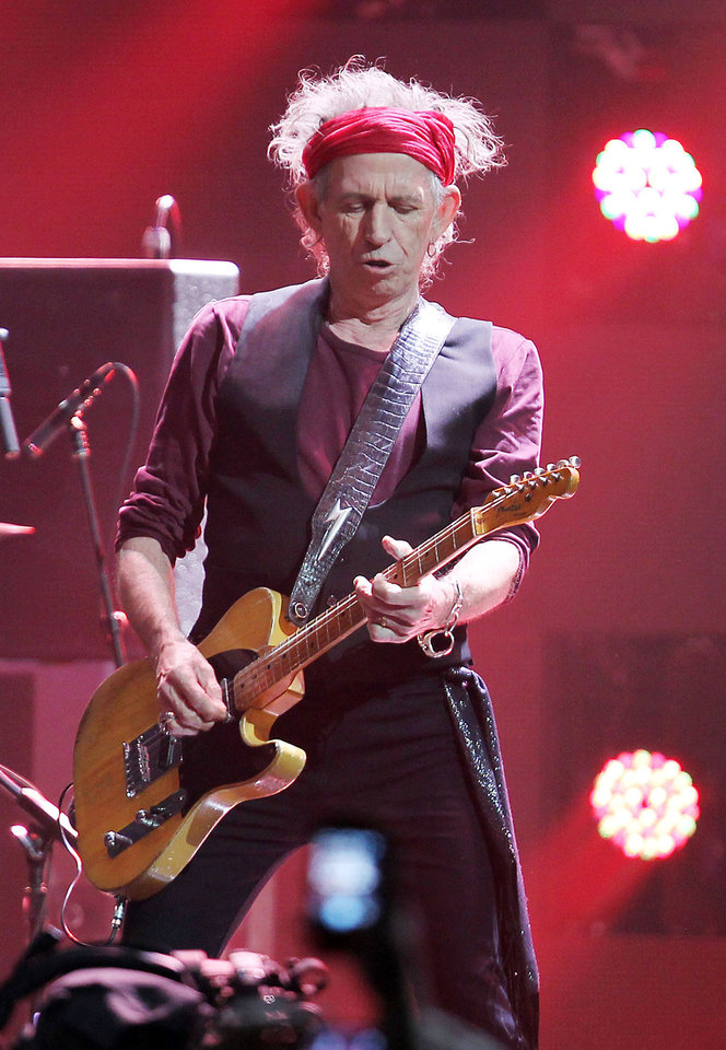 This image released by Starpix shows Keith Richards of The Rolling Stones performing at the 12-12-12 The Concert for Sandy Relief at Madison Square Garden in New York on Wednesday, Dec. 12, 2012. Proceeds from the show will be distributed through the Robin Hood Foundation. (AP Photo/Starpix, Dave Allocca)