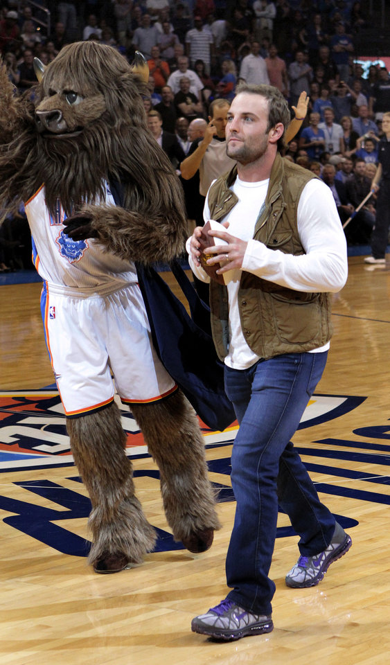 Wes Welker, who played at Heritage Hall, throws autographed balls to the crowd during a timeout at the Oklahoma City Thunder game against Portland on Friday. Photo by Steve Sisney, The Oklahoman