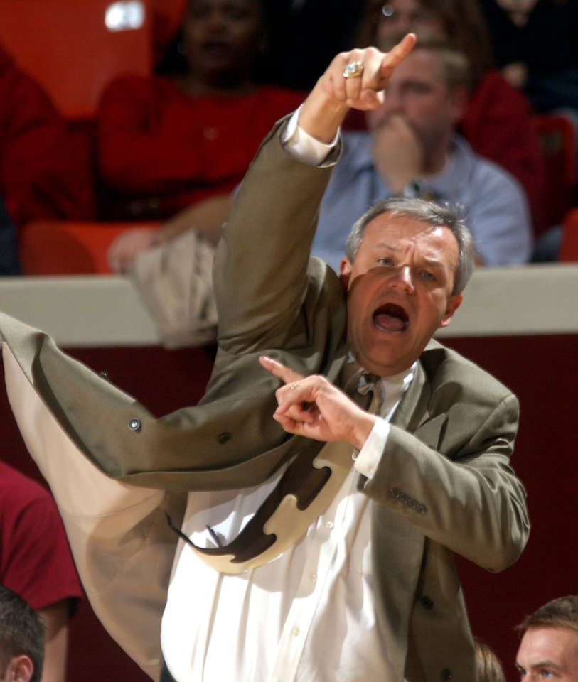 Photo - ** FILE ** Texas-Pan American coach Bob Hoffman encourages his team Monday, Dec. 29, 2003, during a game against the University of Oklahoma (OU) in Norman, Okla. On Monday, May, 10, 2004, Texas-Pan American announced that Hoffman has taken an assistant coach position at Oklahoma. (AP Photo/Jerry Laizure)