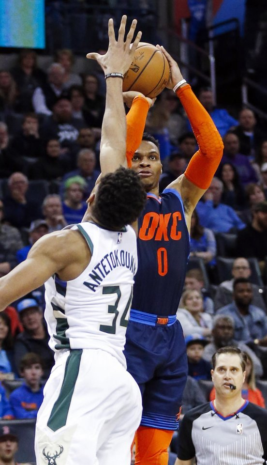 Photo - Oklahoma City's Russell Westbrook (0) shoots against Milwaukee's Giannis Antetokounmpo (34) in the fourth quarter during an NBA basketball game between the Milwaukee Bucks and the Oklahoma City Thunder at Chesapeake Energy Arena in Oklahoma City, Sunday, Jan. 27, 2019. Oklahoma City won 118-112. Photo by Nate Billings, The Oklahoman