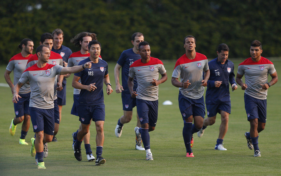 Photo - United States players warm up during a training session in Sao Paulo, Brazil, Tuesday, June 17, 2014.  The United States will play against Portugal in group G of the 2014 soccer World Cup on June 22. (AP Photo/Julio Cortez)