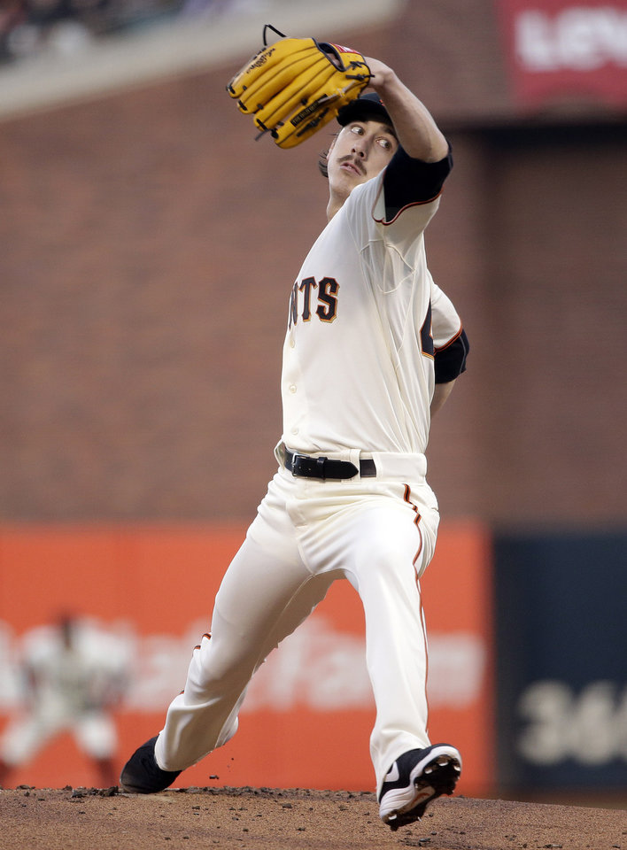 Photo - San Francisco Giants starting pitcher Tim Lincecum throws to the Los Angeles Dodgers during the first inning of a baseball game on Tuesday, April 15, 2014, in San Francisco. (AP Photo/Marcio Jose Sanchez)