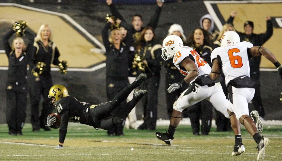 Photo - Colorado's Scotty McKnight (21) dives into the end zone for a touchdown in front of OSU's Andre Sexton (20) and Ricky Price (6) in the third quarter during the college football game between Oklahoma State University and University of Colorado at Folsom Field in Boulder, Colo., Saturday, Nov. 15, 2008. OSU won, 30-17. BY NATE BILLINGS, THE OKLAHOMAN