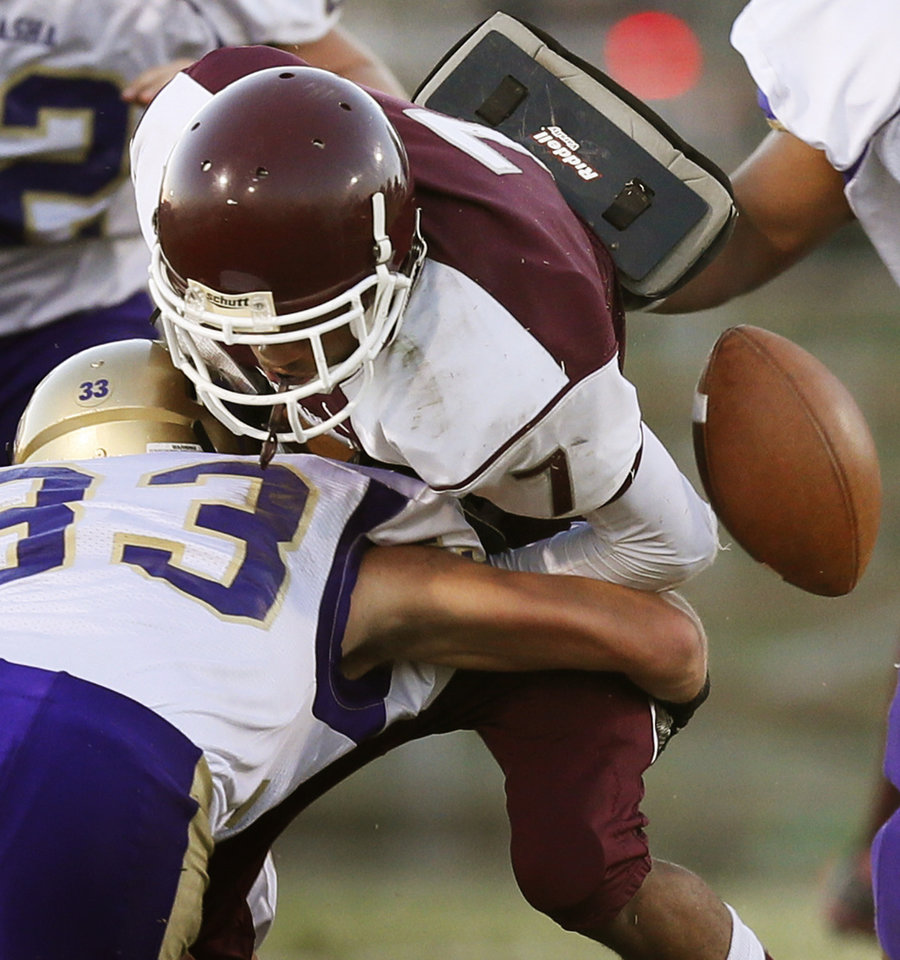 Capitol Hill's Quantino Hall (7) fumbles as he is tackled by Chickasha's Hunter Ford (33) during a high school football game between Chickasha and Capitol Hill at Star Spencer's Carl Twidwell Stadium in Spencer, Okla., Thursday, Oct. 3, 2013. Photo by Nate Billings, The Oklahoman