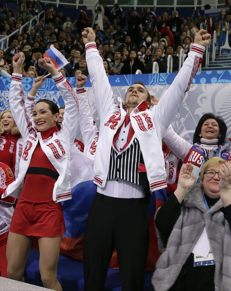 Photo - Ksenia Stolbova and Fedor Klimov of Russia react after competing in the team pairs free skate figure skating competition at the Iceberg Skating Palace during the 2014 Winter Olympics, Saturday, Feb. 8, 2014, in Sochi, Russia. (AP Photo/Darron Cummings, Pool)