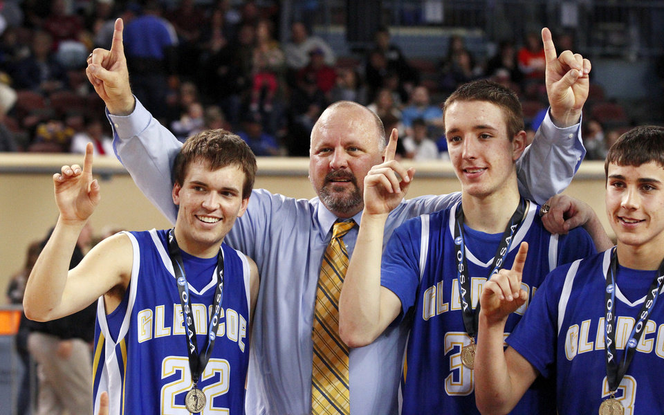 Photo - Head Coach John Lazenby with his sons, Jake, left, and Ty, center and J. K. Hadlock as the players pose for a team photo with their championship medals and trophy after winning the Class A boys high school basketball championship game in the Jim Norick Arena at State Fair Park on  Saturday, March 8, 2014. Glencoe defeated Kiowa, 57-39.  Photo by Jim Beckel, The Oklahoman