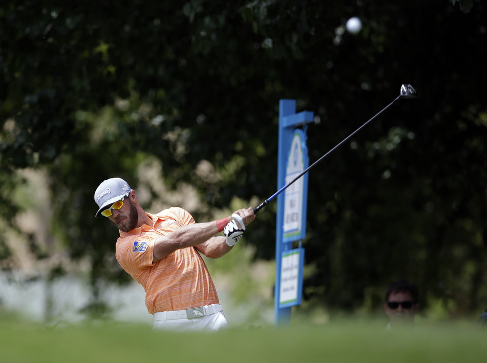 Photo - Graham DeLaet hits off the first tee during the third round of the Byron Nelson Championship golf tournament, Saturday, May 17, 2014, in Irving, Texas. (AP Photo/Tony Gutierrez)
