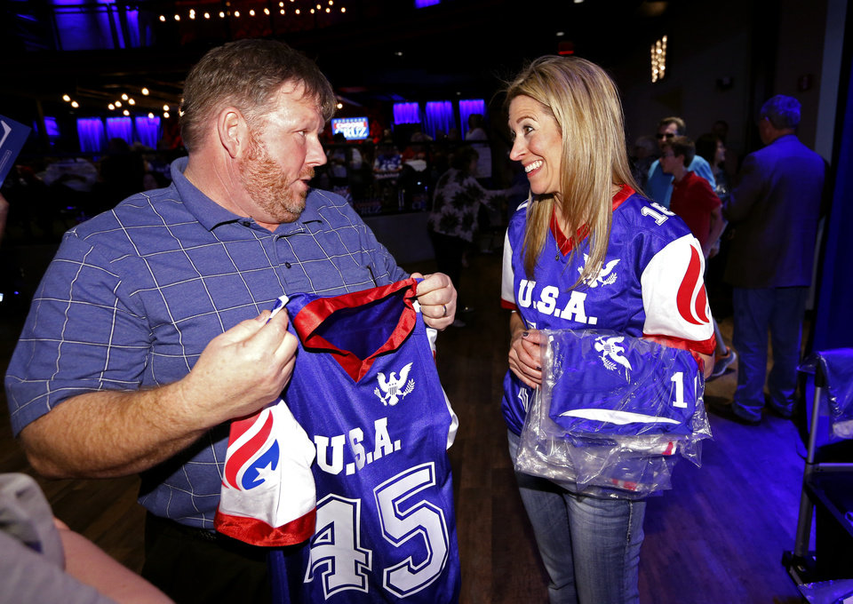 "Photo - Michael Spell tries to find his size jersey from Cathy Lantroop of GOP Jersey at an event at the Chevy Bricktown Event Center featuring Republican presidential candidate Ted Cruz on Sunday, Feb. 28, 2016 in Oklahoma City, Okla.  The ""45"" stands for the 45th President of the United States.  Photo by Steve Sisney, The Oklahoman"