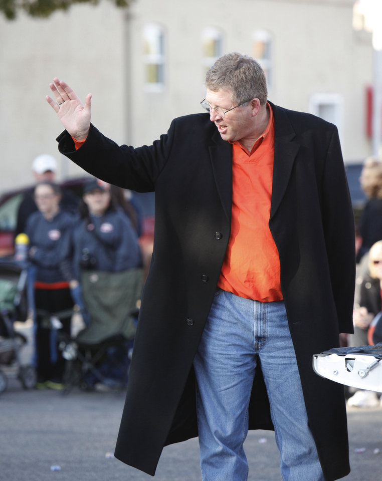 Photo - Rep. Frank Lucas waves to the crown during the Oklahoma State Cowboy's homecoming parade in downtown Stillwater, OK, Saturday, Oct. 29, 2011. By Paul Hellstern, The Oklahoman