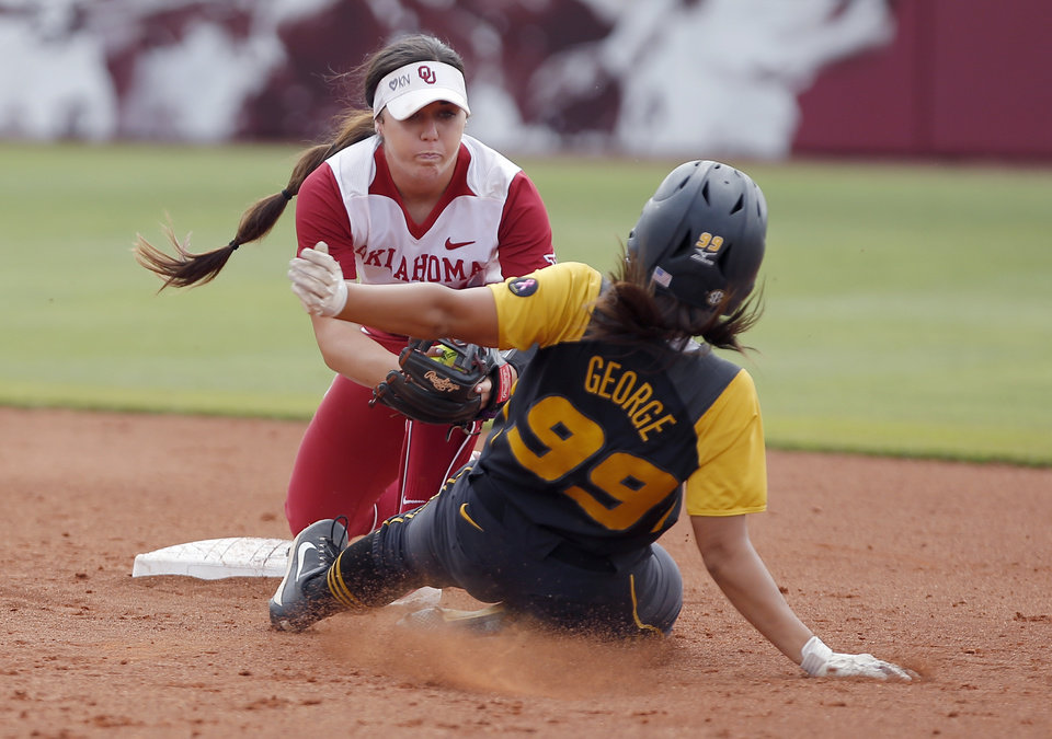 Photo -  OU second baseman Caleigh Clifton tags out Missouri's Abby George in the Sooners 7-0 win over the Tigers Sunday in the NCAA regional in Norman. [PHOTO BY SARAH PHIPPS, THE OKLAHOMAN]