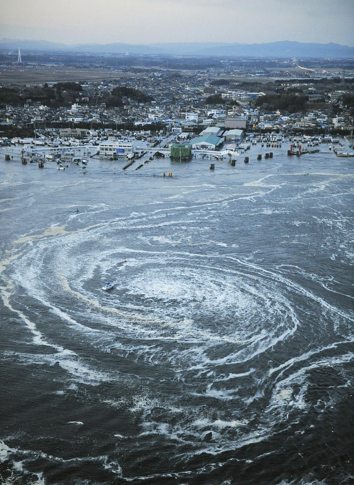 Photo - Tsunami waves swirl near a port in Oarai, Ibaraki Prefecture (state) after Japan was struck by a strong earthquake off its northeastern coast Friday, March 11, 2011. (AP Photo/Kyodo News) JAPAN OUT, MANDATORY CREDIT, FOR COMMERCIAL USE ONLY IN NORTH AMERICA, NO SALES ORG XMIT: TOK835
