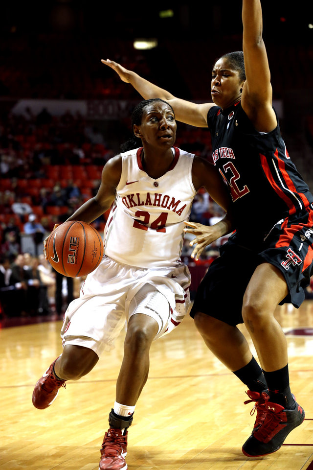 Sharane Campbell (24) drives around Tech's Jackie Patterson (42) as the University of Oklahoma Sooners (OU) play the Texas Tech Lady Red Raiders in NCAA, women's college basketball at The Lloyd Noble Center on Saturday, Jan. 12, 2013 in Norman, Okla. Photo by Steve Sisney, The Oklahoman