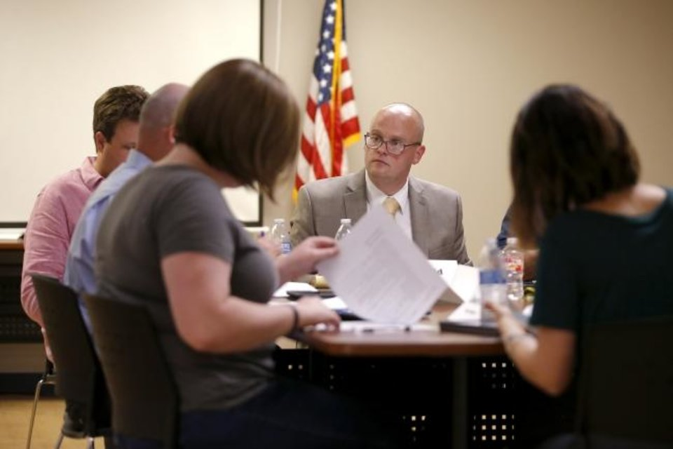 Photo -  Epic Charter Schools Superintendent Bart Banfield speaks during a school board meeting  in Oklahoma City on Aug. 21, 2019. [Bryan Terry/The Oklahoman]