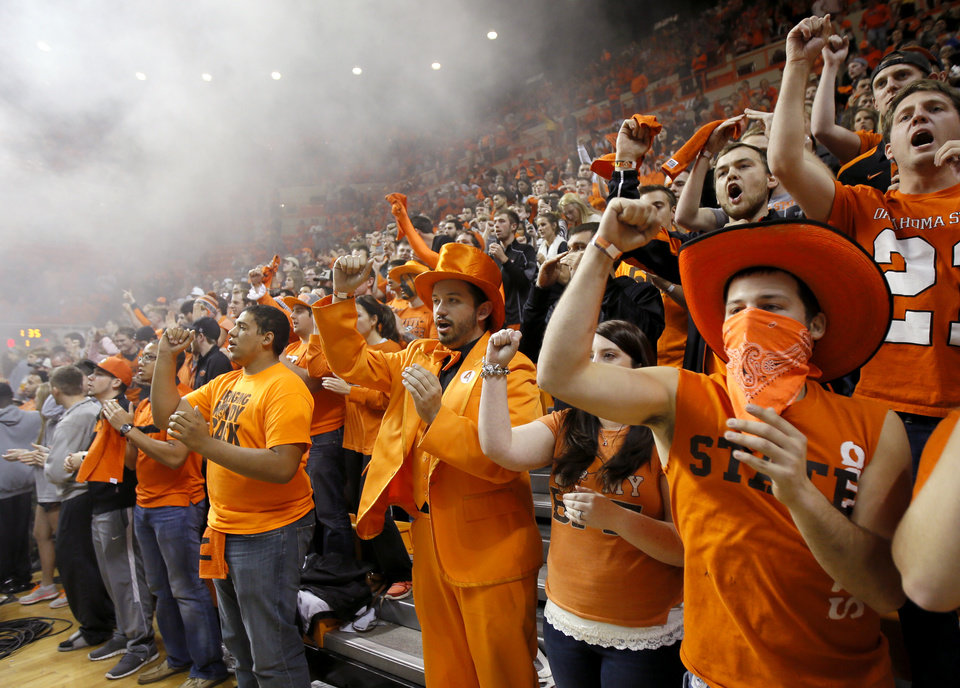 Photo - Oklahoma State fans cheer before an NCAA college basketball game between Oklahoma State and Memphis at Gallagher-Iba Arena in Stillwater, Okla., Tuesday, Nov. 19, 2013. Photo by Bryan Terry, The Oklahoman